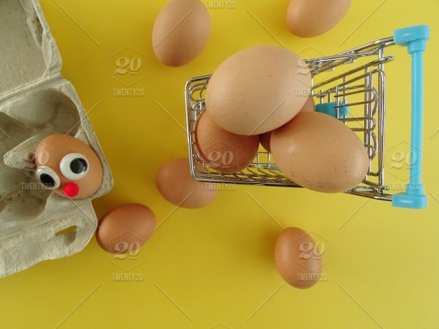 Funny egg in shopping cart stock photo e5a9d4aa-3327-420f
