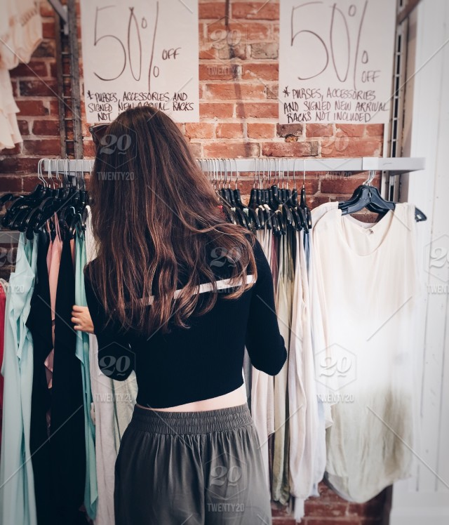 3f317d1880 Girl shopping in a retail clothing store 💲 ✨NOMINATED✨ stock photo  039b50a0-d68a-46a3-94ae-caead93aa753