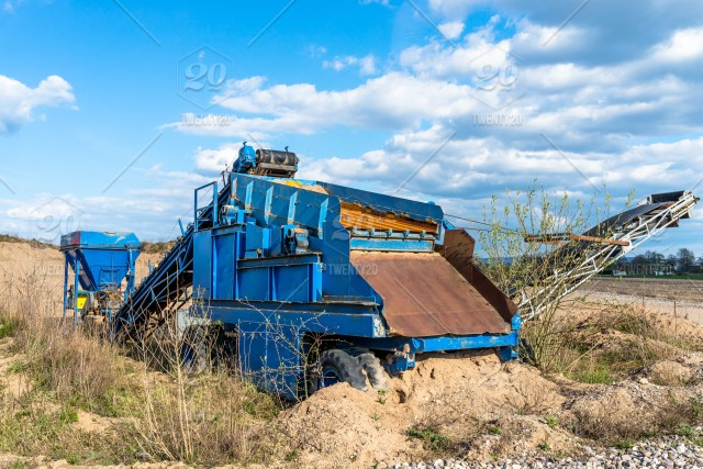 Old, mobile screen for gravel and sand in blue color
