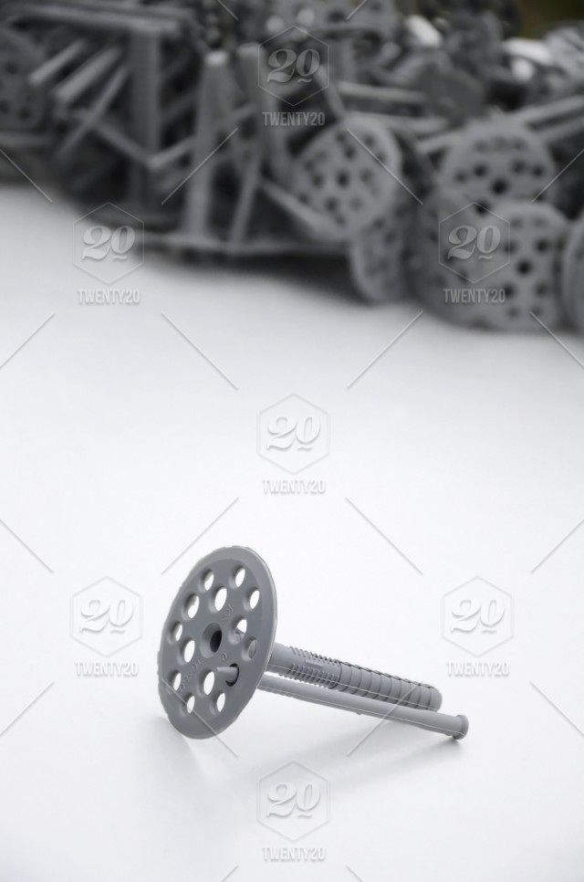 A gray plastic dowel fastening for thermal insulation with