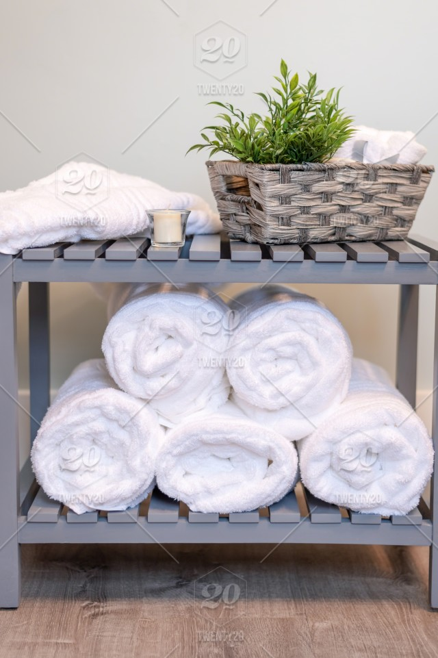 . Fluffy white towels rolled and stacked   bath  bathroom  bath time