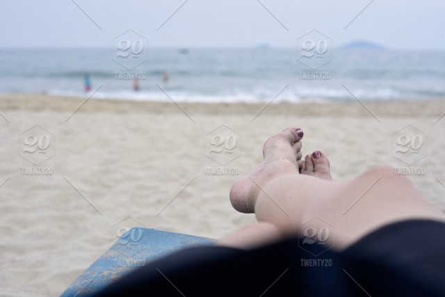 Summertime, chilling out lying at the beach, perspective  stock