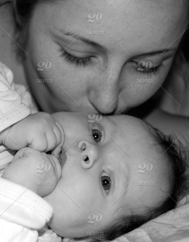 Motherhood Education Parenting Concept Mother Kissing Her Baby Close Up Portrait Black And White Stock Photo 27754749 D68e 46bd 9c54 E09f8d02d978