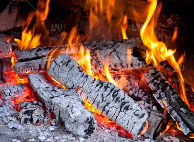 Burning Wood Fireplace With Flames Ashes And Sparks Stock