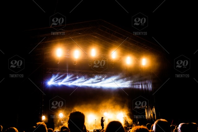 Picture of a lot of people enjoying night perfomance, large