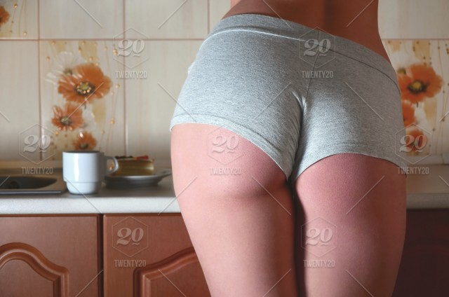 Hot babes with hot ass Rear View Of A Sexy Caucasian Girl With A Sports Body Standing At The Kitchen Counter In Her Underwear Next To Her On The Kitchen Top Is A Cup Of Hot Coffee