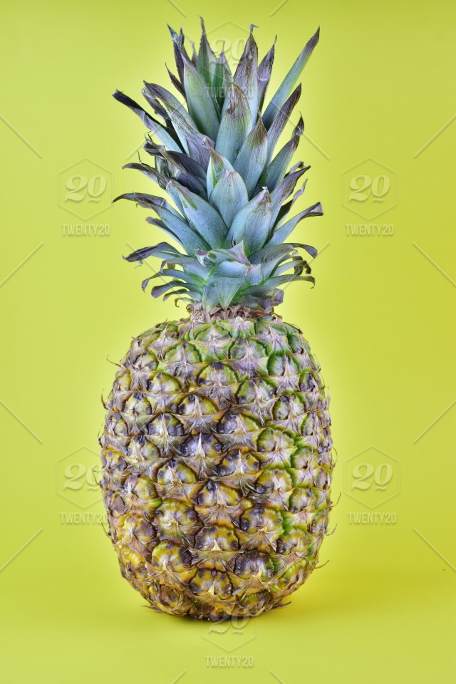 stock photo yellow colorful fruit pineapple tropical fruit wallpaper background summer food summertime 592f3143 9ecc 497b 9087 a95a0cc507ba