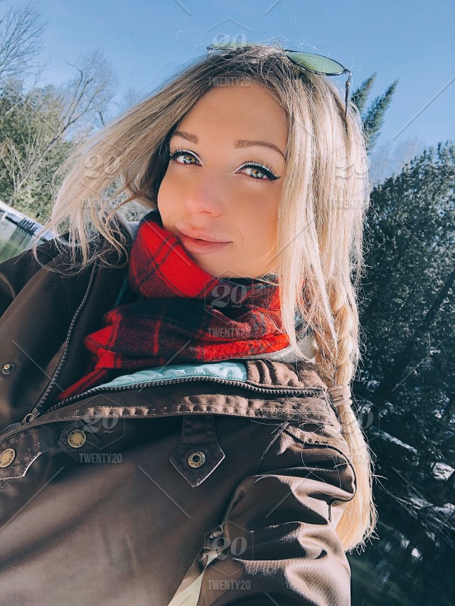 Beautiful Young Blonde Girl With Glowing Skin And Green Eyes Selfie