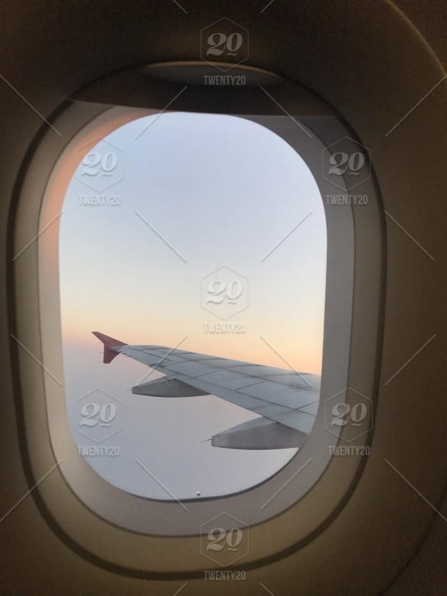 Sunny And Clear Sky View From Aircraft Window Near Be The Wing