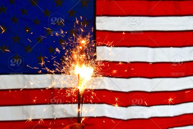 Patriotic Christmas Background.Celebrating The 4th Of July Holding A Bunch Of Lit