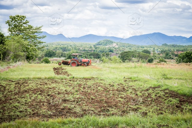 Tractor Working On The Farm A Modern Agricultural Transport A Farmer Working In The Field Fertile Land Tractor On A Cloudy Background Cultivation Of Land Agricultural Machine Agricultural Agriculture Background Beautiful Blue Care