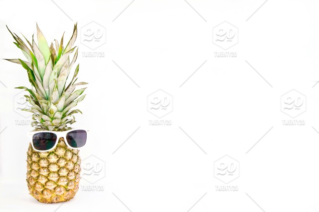 Pineapple dude wearing sunglasses with plenty of white space