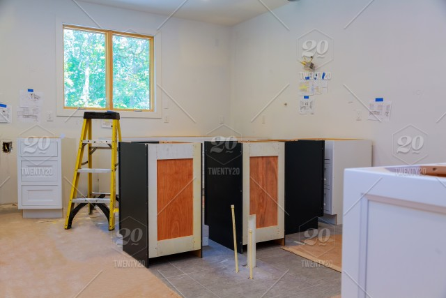 Custom Kitchen Cabinets In Various Stages Of Installation Base For