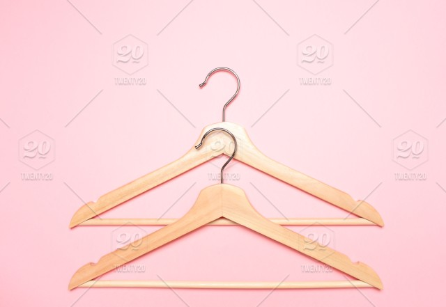 Wooden Coat Hangers For Clothes On A Pink Background Fitting Gauge Sewing Cut Clothing Store Wooden Simple Fashion Fashionable Fashion Designer Design Couturier Fashion Design Clothes Trade Shop Sale Hangers Hanger
