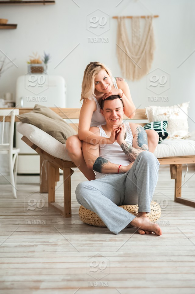 Couple Love House Loving Couple At Home In The Kitchen In A Rustic Style Relationship Concept Tattoo Couple Stock Photo E17d2565 028d 407b A4f1 C749a2d2d623