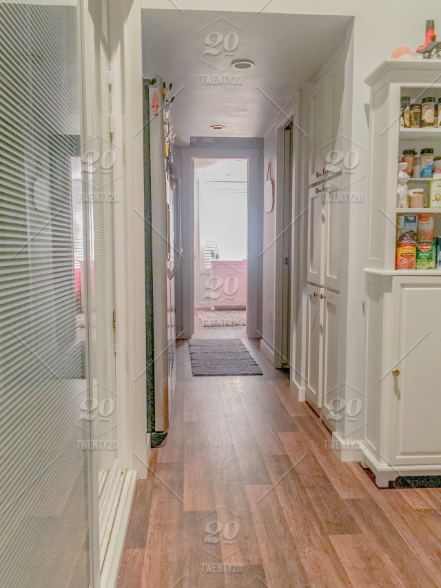 Looking Down The Hallway Of A Tiny House Wooden Floors And White Cabinets In A Small 350 Square Foot House Stock Photo 9ffa070d 21f0 4748 81a5 Bcb4de776f86