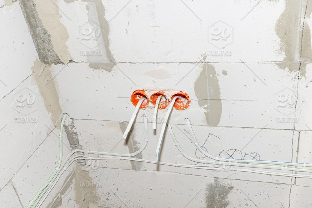 Orange, round junction box mounted in the white wall with ... on electrical fire, electrical wire, electrical circuits, electrical receptacle types, electrical repair, electrical energy, electrical conduit, electrical shocks, electrical engineering, electrical fuses, electrical contracting, electrical cables, electrical grounding, electrical box, electrical equipment, electrical tools, electrical diagrams, electrical cord, electrical technology, electrical volt,