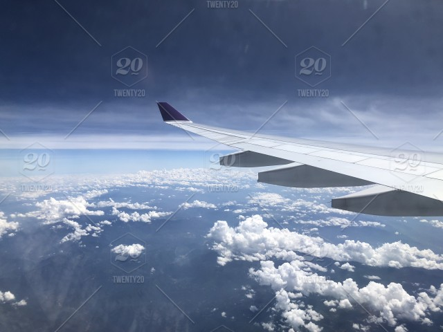 Airplane Window Seat View With The Beautiful Cloud Sky Stock Photo