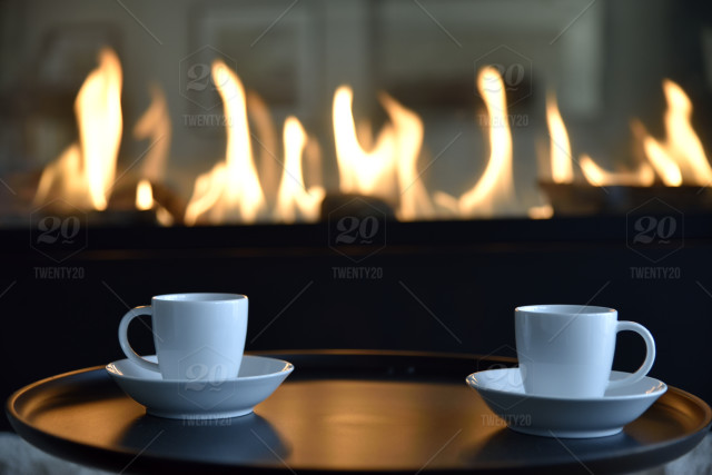 Espresso Coffee Cups On Small Table Next To Fireplace No People