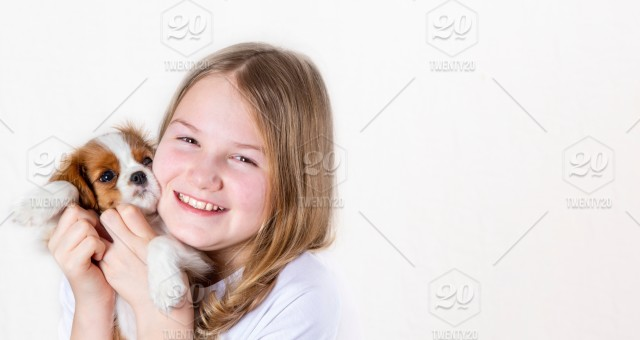 Portrait Happy Young Girl Holding Cute Purebred Puppy Cavalier King Charles Spaniel With Red Bow On White Background Isolated Banner Stock Photo 6fcf3d0a 0772 4475 Bbce 194cd3d2a03c