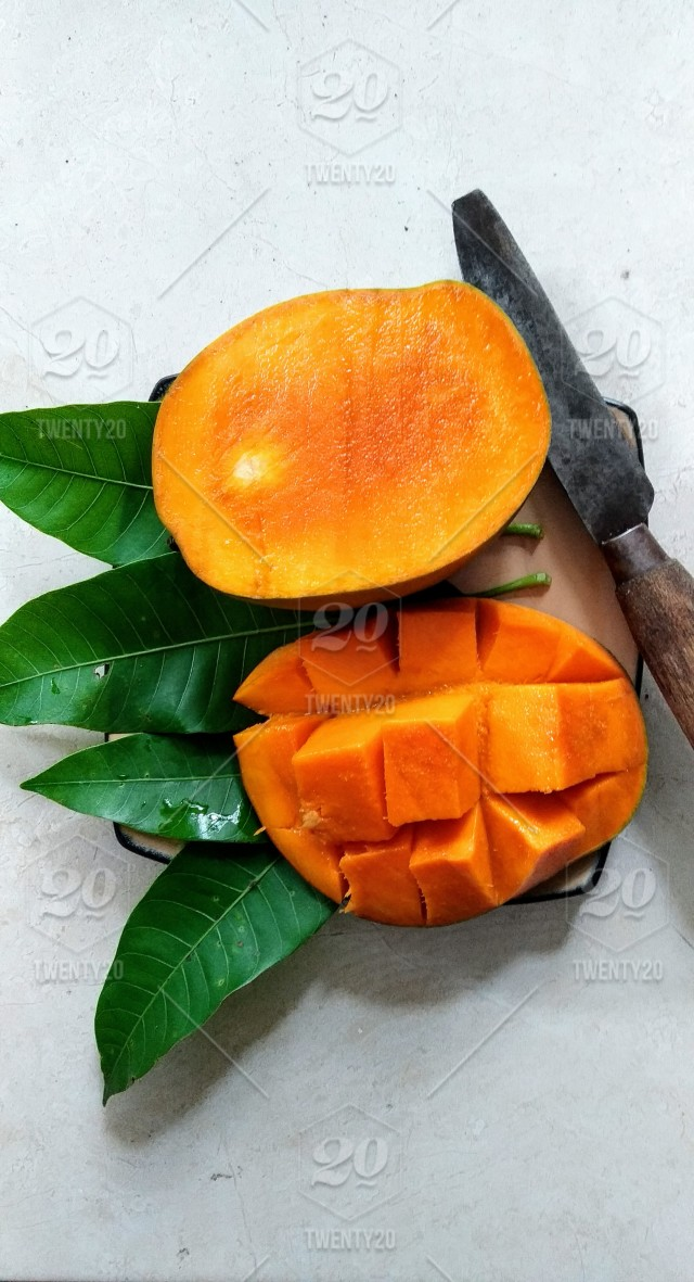 Full Close Up Shoot Of Mango Fruit Stock Photo 1ccb3f84 F072 4be5 Be38 E160ec7932e5