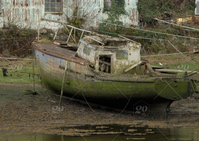 Derelict Old Fishing Boat Showing Broken Wooden Cabin And Green Hull Unloved And Abandoned Wreck At High Tide Grass Growing On The Deck Ropes Covered In Weed Still Attached Stock Photo 5bb537fa 9784 4c94 A373 024c68dc5dbc