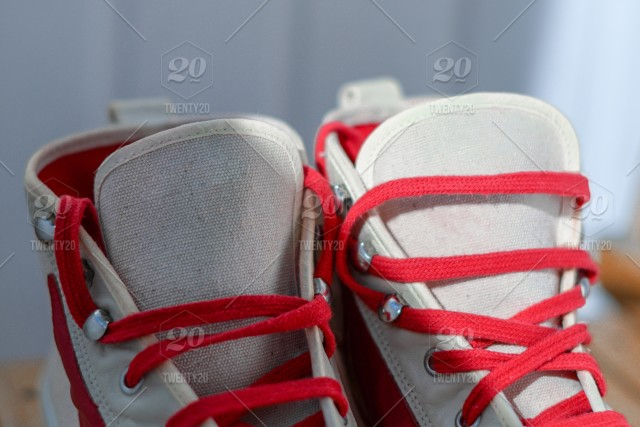 White sneakers with red laces stock