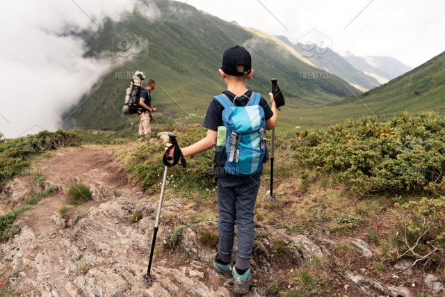 Hiking; outdoor; lifestyle; family; adventure; backpack; people; child;  father; son; nature; mountain; man; travel; dad; boy; parent; together;  active; activity; young; tourist; kid; leisure; walking; adult; hiker;  healthy; summer; day; person; trekking;