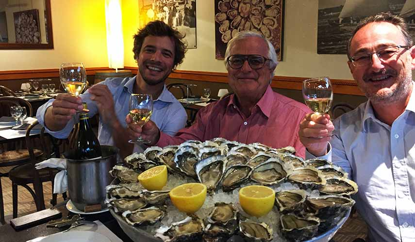 Bordeaux négociants Thomas, Archie and Ivanhoé Johnston enjoying a classic pairing of white Bordeaux and oysters.