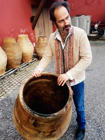 Panagiotis Papagiannopoulos, the wonderful winemaker at Tetramythos, with one of his amphorae
