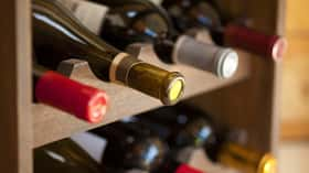 How should I store and age wine?