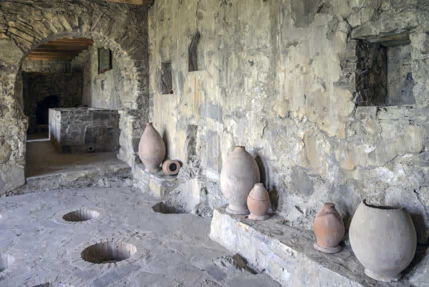 Large clay vessels for holding wine called kvevri buried underground in Kakheti region, Georgia