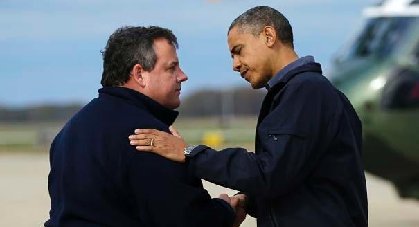 President Barack Obama is greeted by New Jersey Gov. Chris Christie upon arrival at Atlantic City International Airport in Atlantic City, N.J., to visit areas damaged by Superstorm Sandy.