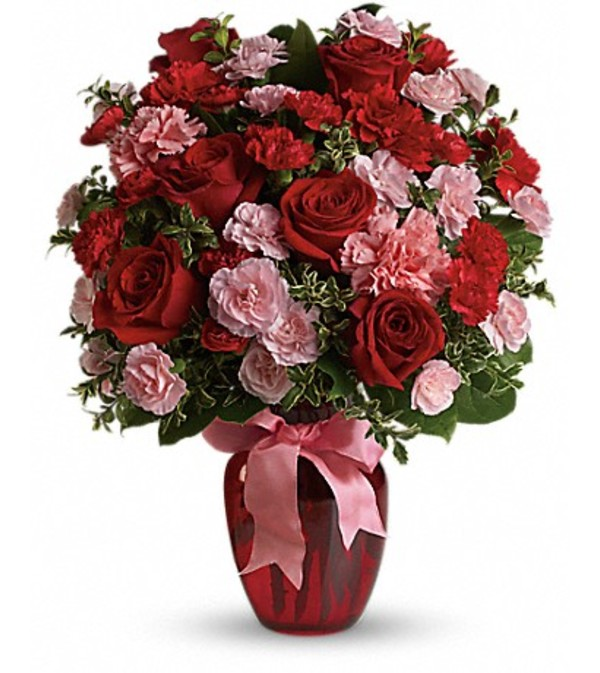 Red Roses and Pink Mini Carnations in Red Vase