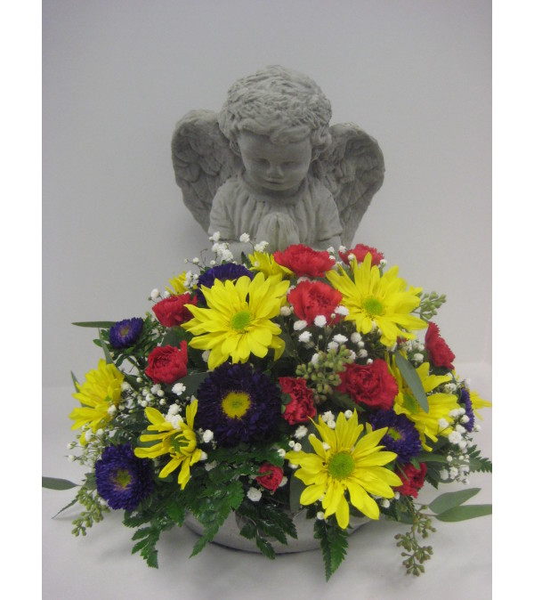 Sympathy angel with an arrangement in the bowl