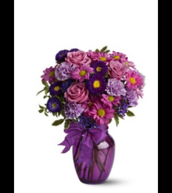 ASSORTED PURPLE FLOWERS ARRANGED