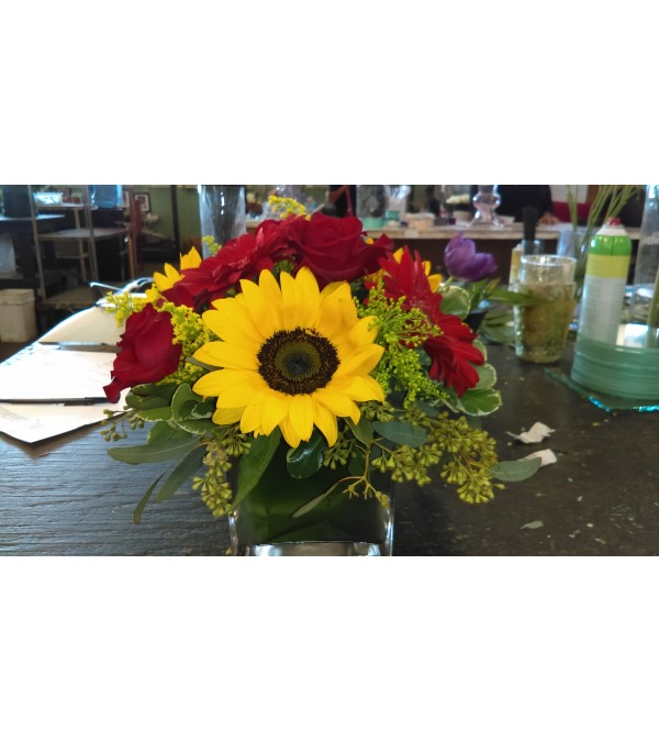 sun flower, gerber daisies and rose arrangement