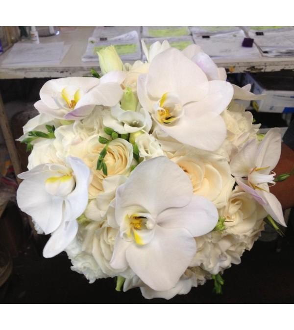 vendela fressias, lisianthus & philanopsis bridal bouquet 1