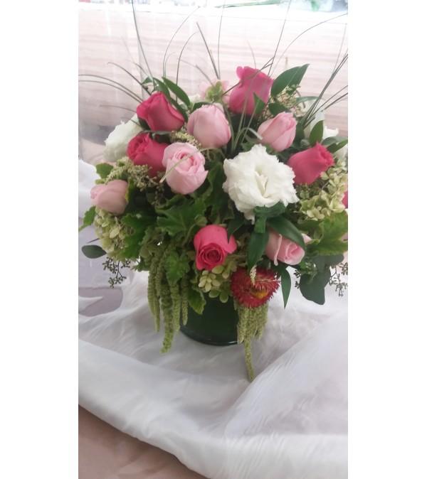 all shades of pink cylinder arrangement