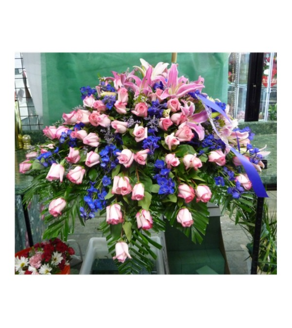 CASKET SPRAY- ROSES, DELPHINIUM, AND LILIES