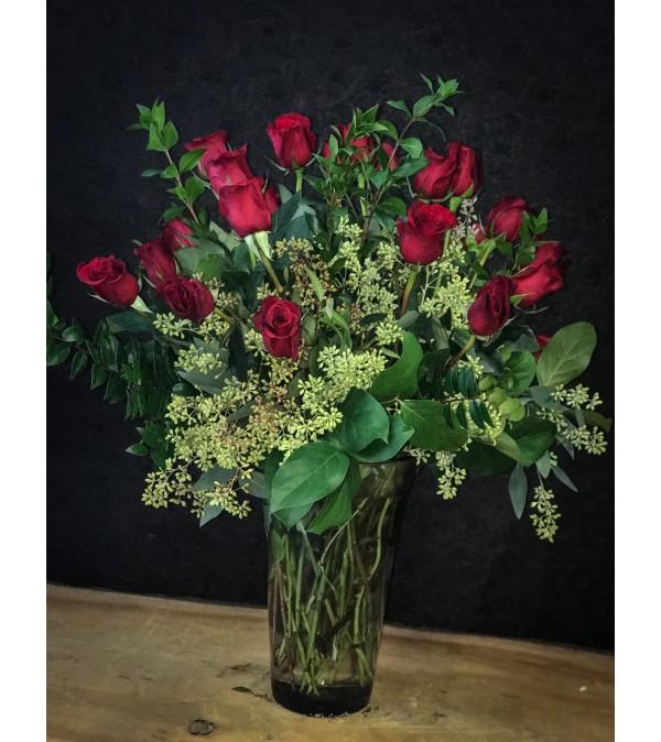 2 doz. premium rosa prima roses in a vase