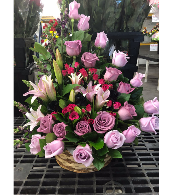 A Sympathy Basket with Shades of Purple Roses