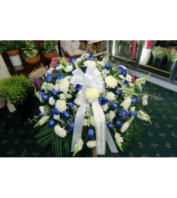 blue and white casket cover with blue roses
