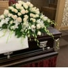 All WHITE roses and orchids Casket Spray deluxe