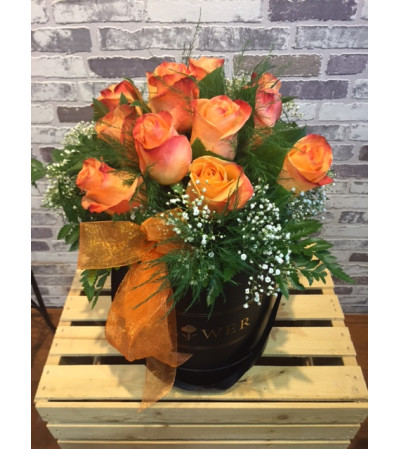 12 premium Orange roses in a box