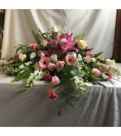 Pink and white casket cover