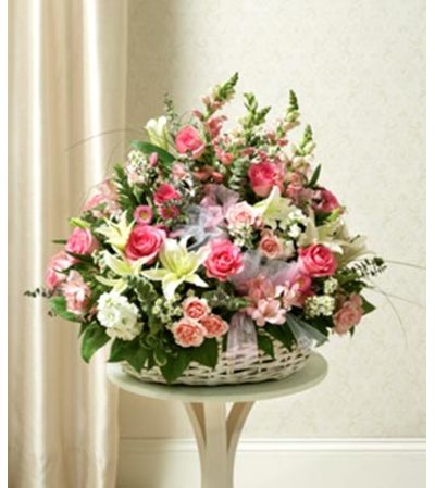 Three- Sided arrangement of Assorted pink flowers in basket .