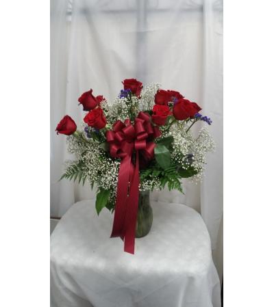 red rose vased