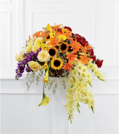 The FTD® Peaceful Tribute™ Basket Arrangement