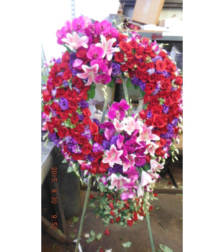 red roses purple lisianthus open wreath